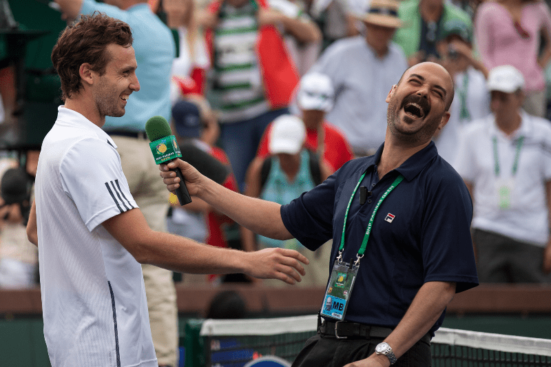 Indian Wells Stadium 2 Emcee Andy Taylor with Ernests Gulbis