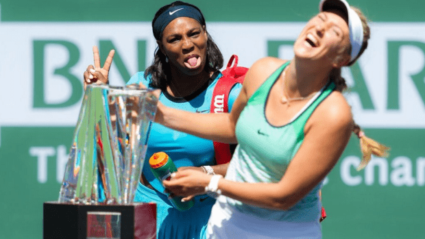 Serena photo-bombs Victoria Azarenka's trophy hoist