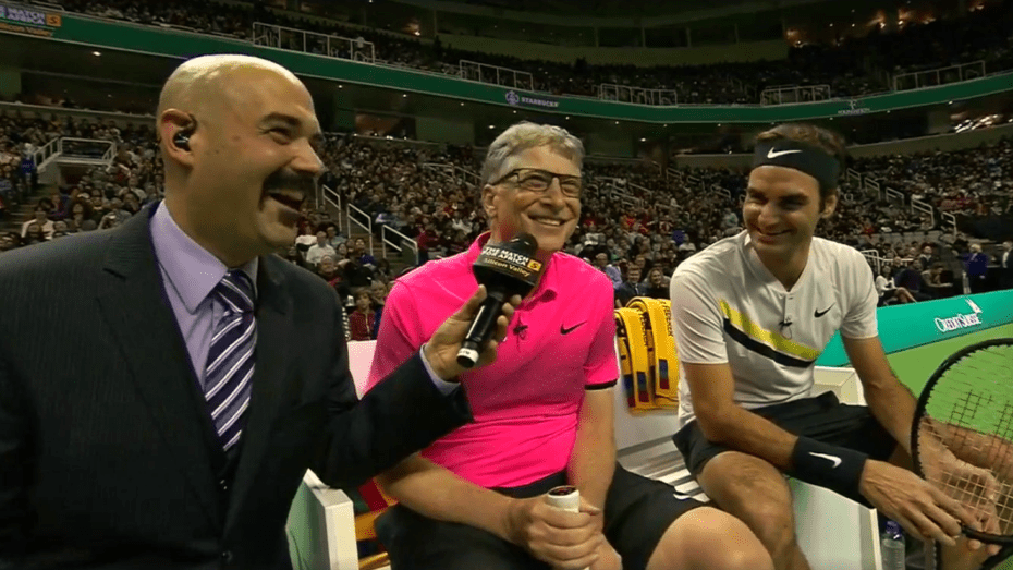 Announcer Andy Taylor. Match for Africa 5. Bill Gates and Roger Federer defend their title.